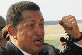 Hugo Chavez humilla a España ante el Rey y ZP